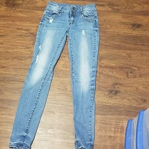Distressed mid-rise jeans